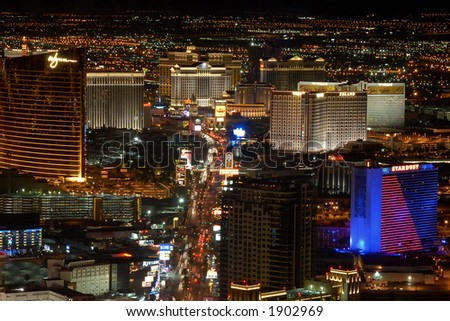 Fabulous Las Vegas by night, view of the Strip from the Stratosphere hotel tower (long exposure) - stock photo
