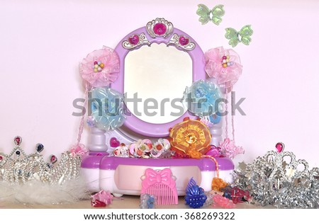 Fabulous mirror for the little Princess with a crown and accessories - stock photo
