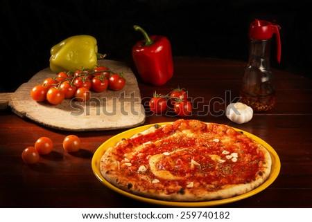 Fabulous pizza marinara with garlic and vegetables - stock photo