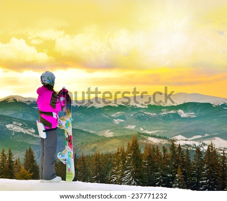 fabulous sunrise in the mountains and snowboarder - stock photo