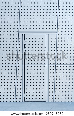 Facade and door of modern architecture - stock photo