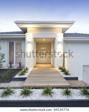 Facade and entry to a contemporary white rendered home in Australia - vertical - stock photo