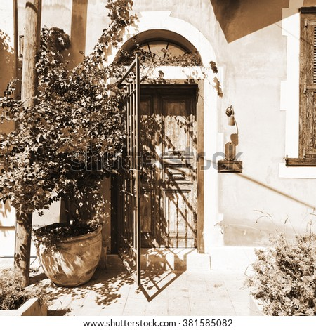 Facade Decorated with Flower in Tel Aviv, Vintage Style Sepia  - stock photo