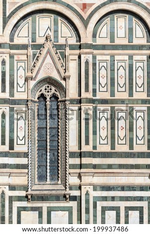 """Facade detail with window of the famous dome """"Santa Maria del Fiore"""" in Florence, Italy - stock photo"""