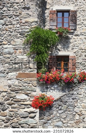 Facade in the medieval village of Yvoire, France - stock photo