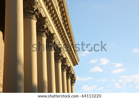 Facade of a building with columns in style neoclassicism against the sky