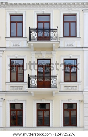 Facade of a building with windows - stock photo