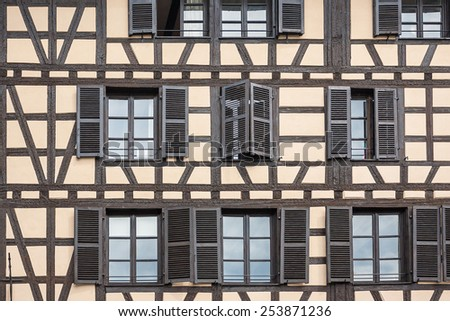 "Facade of a building with windows in the historic district ""Petite France"" in Strasbourg, Alsace, France - stock photo"