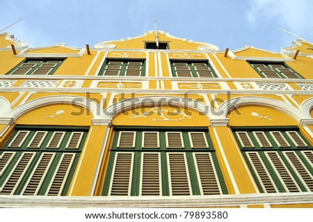 Facade of a colonial house in Willemstad, the capital of Curacao, in the Caribbean. Downtown Willemstad is a UNESCO World Heritage Site. - stock photo