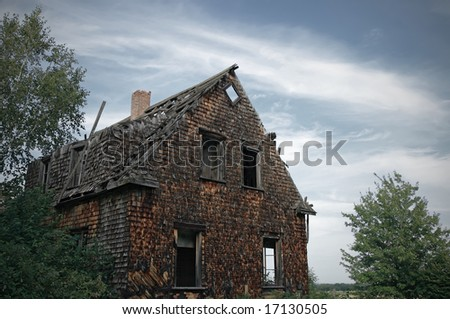Facade of a gloomy haunted house. - stock photo