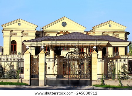Facade of a massive building with galleries  - stock photo