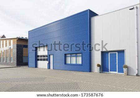 facade of a modern blue warehouse - stock photo