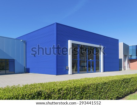 facade of a modern blue warehouse - stock photo