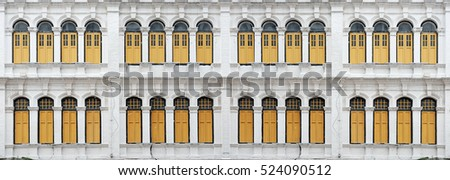 Facade of a row of vintage Dutch neoclassical architectural design.