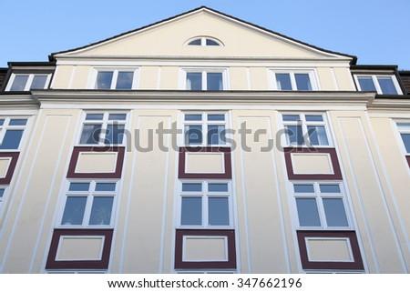 Facade of a traditional apartment building - stock photo