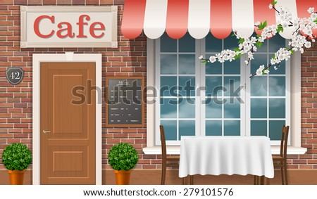 Facade of a traditional cafe with a window, door, awnings. - stock photo