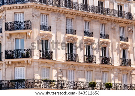 facade of a typical building in paris - stock photo