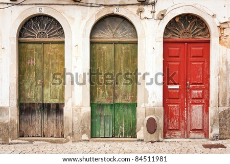 facade of abandoned building with three doors - stock photo