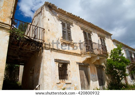 Facade of an abandoned house in Assos on the Greek ionian island Kefalonia, damaged by an earthquake in 1953, Venetian architecture  - stock photo