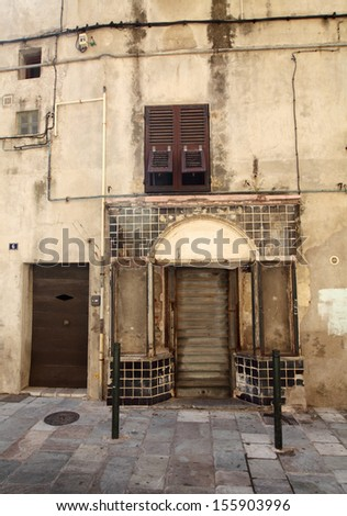 Facade of an empty old shop or restaurant - stock photo
