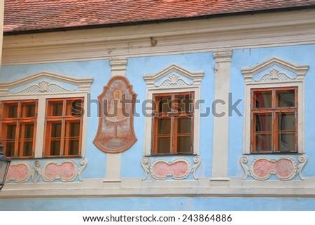 Facade of an historical building on the streets of Cesky Krumlov, Czech Republic - stock photo