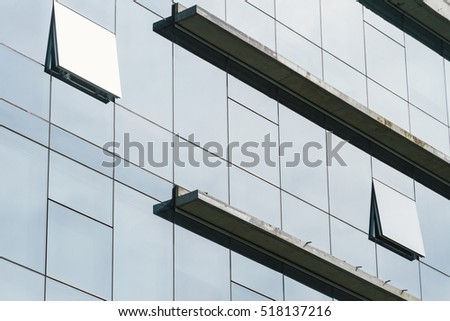Facade of an office building with two open spangled windows