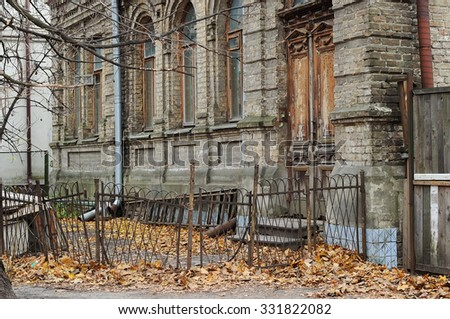 Facade of an old, abandoned house in autumn - stock photo