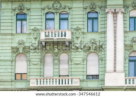 Facade of an old apartment building in Budapest Hungary - stock photo
