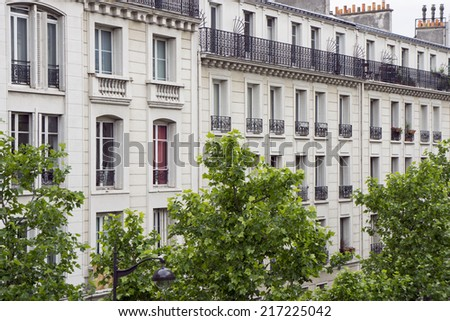 Facade of an old apartment building in Paris, France - stock photo