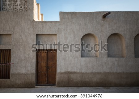 Facade of an old Arabic house. Old arabian architecture. - stock photo