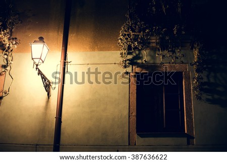 Facade of an old building in Italy. - stock photo