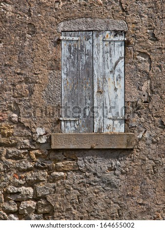 Facade of an Old French House With Window Panes and Window Shutters - stock photo