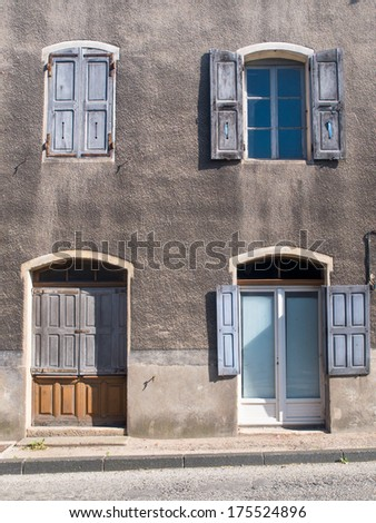 Facade of an Old French House With Window Panes and Window Shutters
