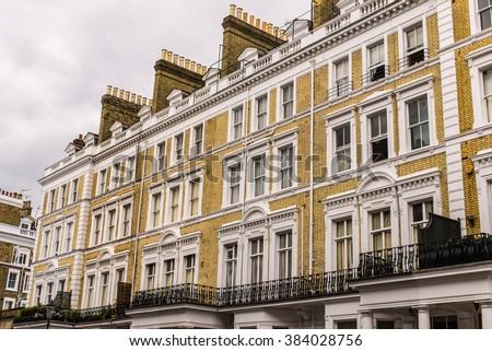 Facade of an opulent  British Victorian Edwardian terraced flat in South Kensington, London. - stock photo