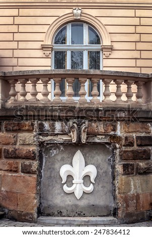 Facade of historical building in the center of the city of Lviv in Ukraine lit bright summer sun - stock photo