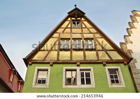 Facade of medieval house in old town Rothenburg ob der Tauber, Bayern, Germany - stock photo