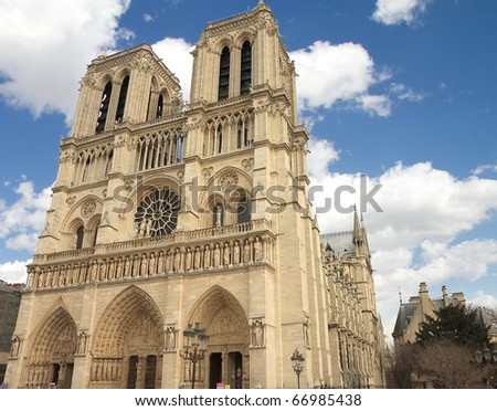 facade of Notre dame with cloudy sky in paris - stock photo
