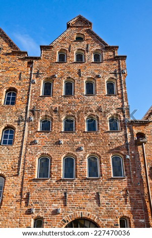 Facade of old buildings in Lubeck, Germany - stock photo