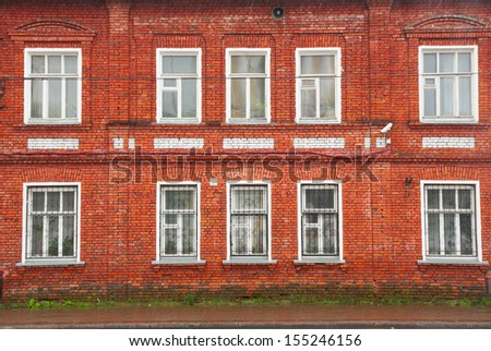 Facade of old red brick  house