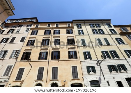 facade of old residential building in rome, italy - stock photo