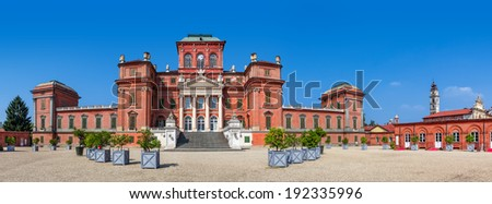 Facade of Racconigi palace - former royal residence of Savoy house in Piedmont, Northern Italy (panorama). - stock photo