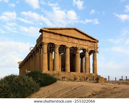 Facade of ruined ancient Greek temple in Agrigento in evening sunset light. Sicily Italy