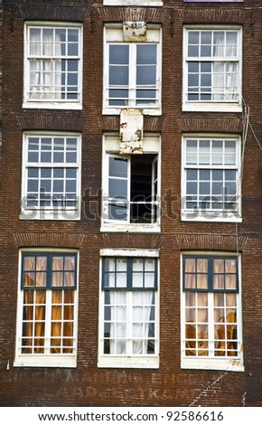 Facade of the Holland house with windows. Amsterdam. Fregment. Frontally - stock photo