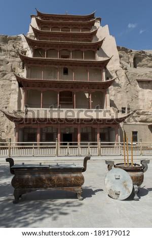 Facade of the Mogao Caves, Dunhuang, Jiuquan, Gansu Province, China - stock photo