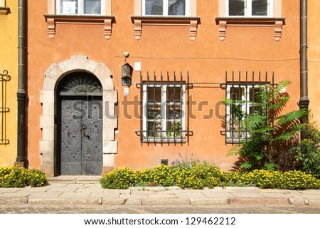 Facade of the old building in Warsaw, Poland - stock photo