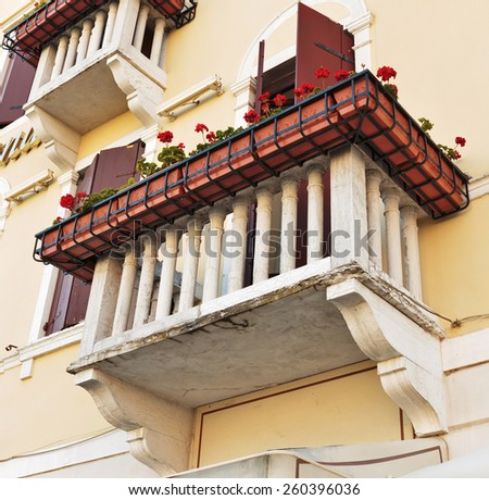 Facade of the old Italian house in Venice - stock photo