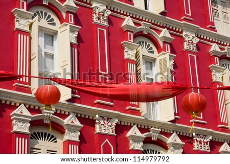 Facade of the red building in China Town, Singapore. - stock photo