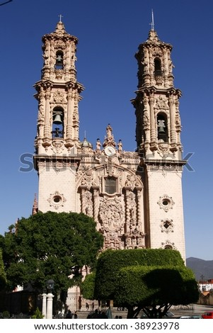 Facade of the Santa Prisca Church in a small town of Taxco, Guerrero, Mexico. It was built by Jose de la Borda in 1751-1758 and is one of the few Baroque constructions in the state of Guerrero - stock photo