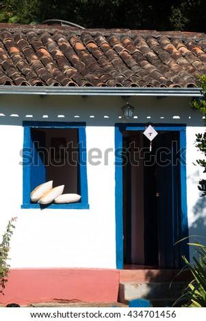 facade  of the village house - stock photo