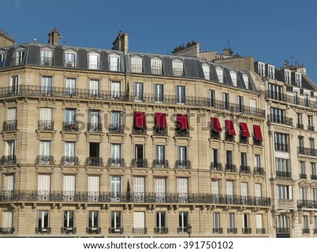 Facade of traditional apartment buildings in Paris, France - stock photo